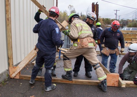 These MA-TF1 members need to know how to protect themselves from harm when they're searching for survivors in unstable or collapsing structures. Here, as part of an 80 hour structural collapse training course, they practice shoring--working on ways to prop up debris and keep it from falling on rescuers. Photo by Eilis Maynard - Oct 24, 2014 - Location: beverly, MA